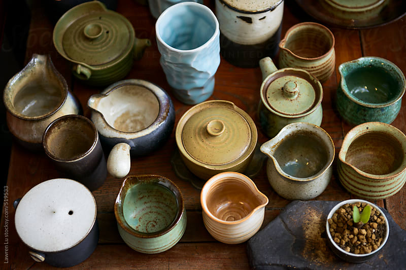 Various pottery cups for making tea by Lawren Lu for Stocksy United