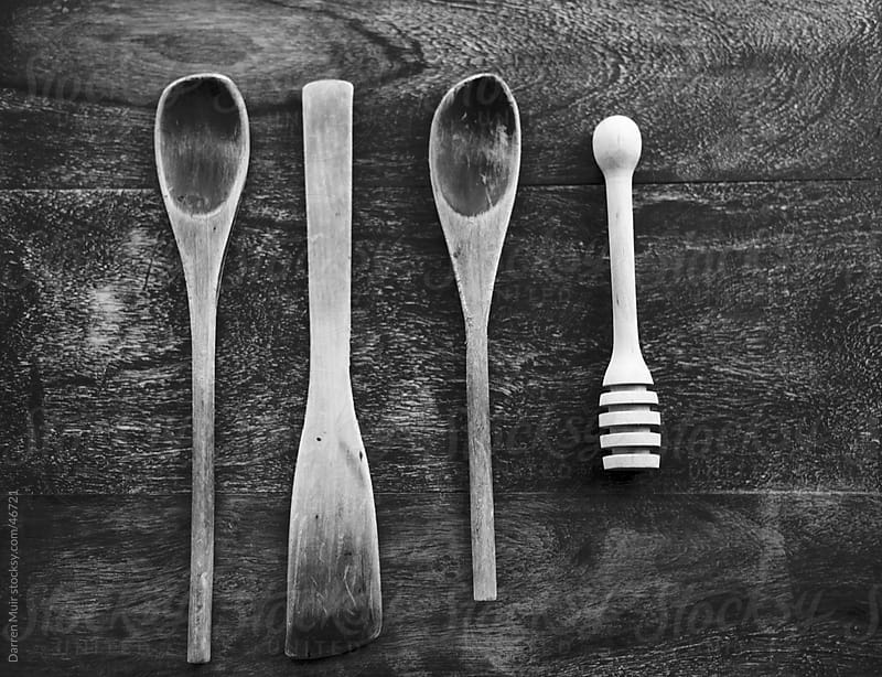 Old wooden spoons and honey swirl. by Darren Muir for Stocksy United