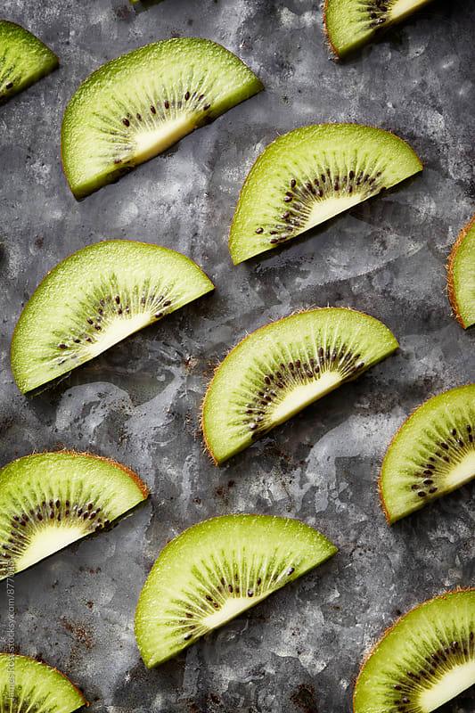 Sliced kiwi fruit by James Ross for Stocksy United