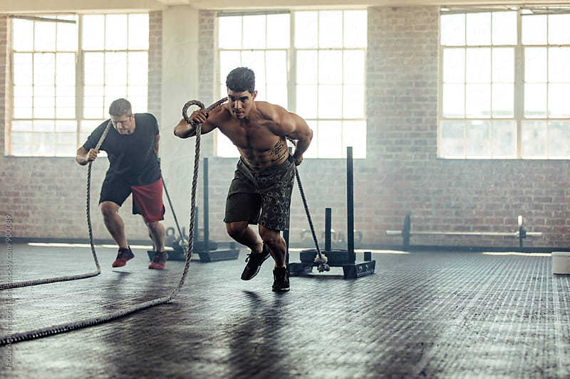 Athletes in gym circuit training by Jacob Lund for Stocksy United