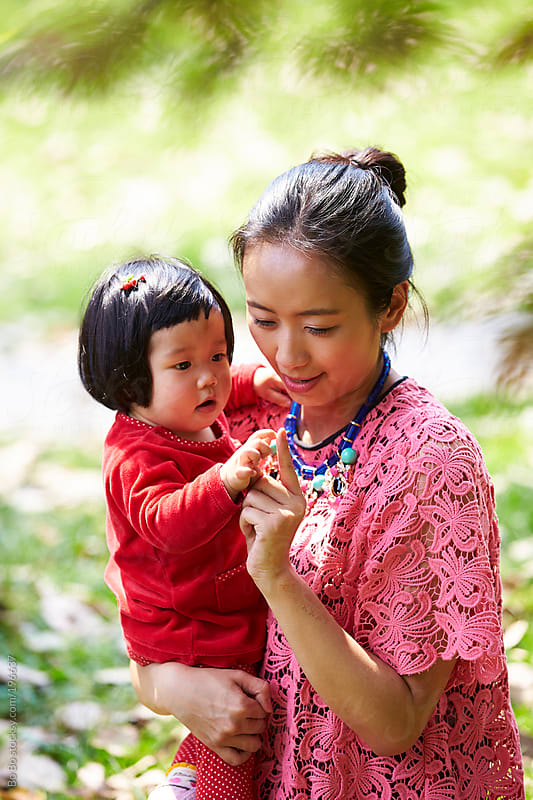 Young asian mother and her baby by Bo Bo for Stocksy United