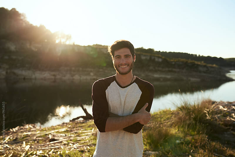 Smiling handsome man looking at camera by Guille Faingold for Stocksy United