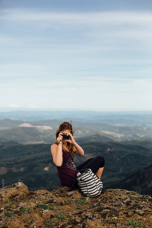 Woman Taking Photo on Mountain by Evan Dalen for Stocksy United