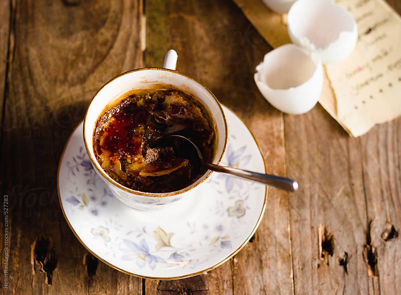 Spiced pumpkin and brown sugar creme brûlée in a teacup by Helen Rushbrook for Stocksy United