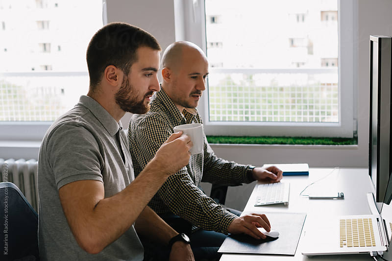 Two Colleagues Working Together at the Office by Katarina Radovic for Stocksy United