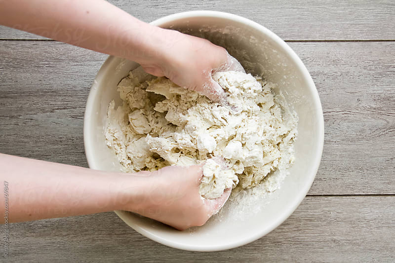 Hands rubbing in fat into flour to make pastry by Kirsty Begg for Stocksy United