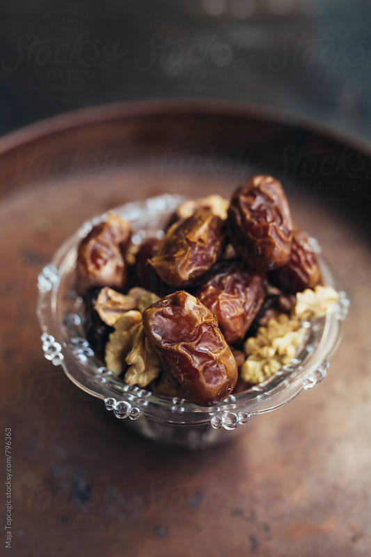 Date palm on a brown saucer by Maja Topcagic for Stocksy United