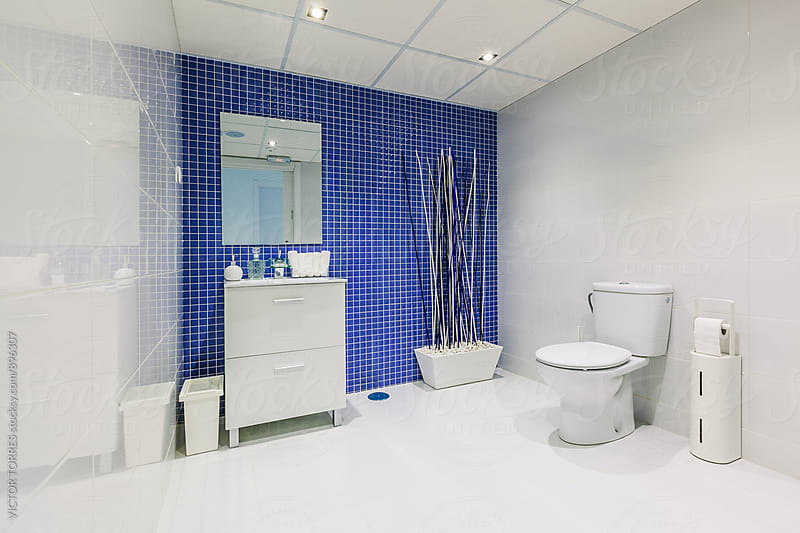 Modern White Bathroom by VICTOR TORRES for Stocksy United