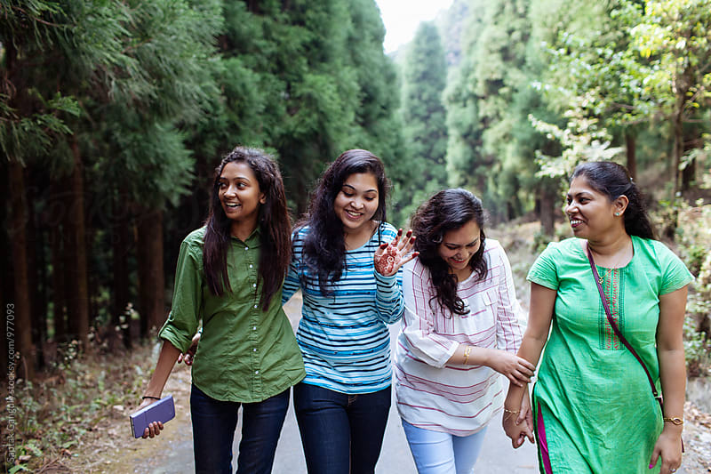 Group of friends having fun outdoors by Saptak Ganguly for Stocksy United