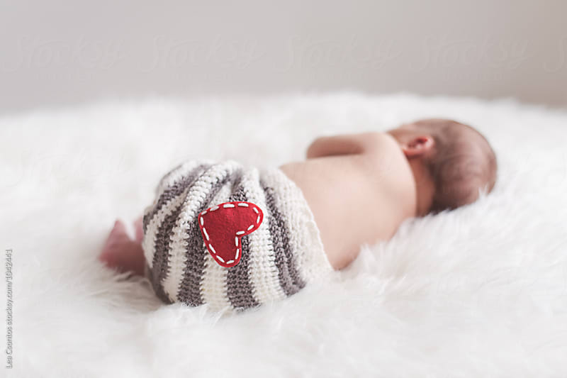 Sleeping newborn baby from behind  by Lea Csontos for Stocksy United