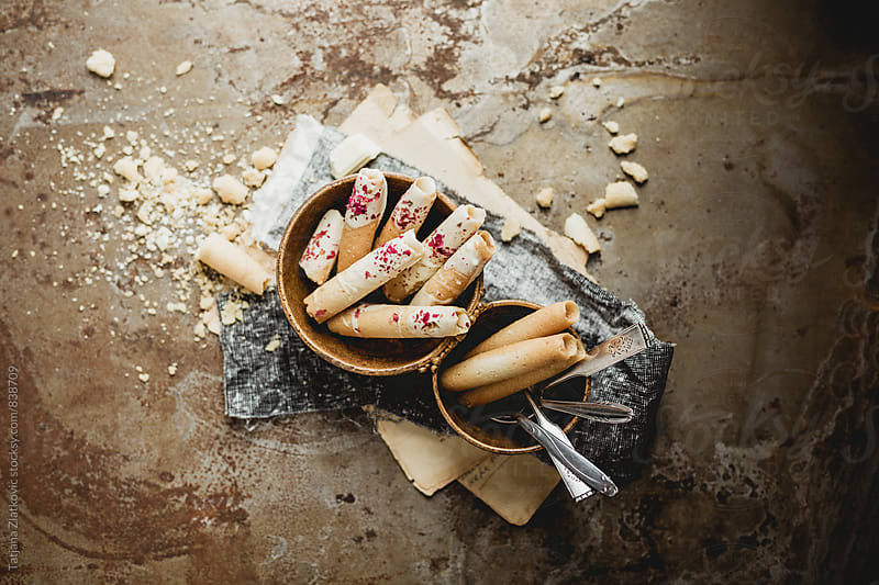 Cigarette cookies with white chocolate and rose buds by Tatjana Ristanic for Stocksy United