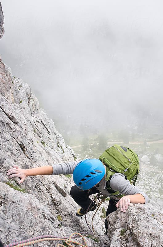 Woman with backpack rock climbing outdoor by RG&B Images for Stocksy United