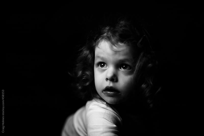 Black and white portrait of a little girl by Craig Holmes for Stocksy United