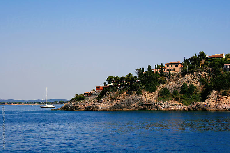 Sight of Argentario promontory from the ferry-boat for Giglio island, in Italy by Laura Stolfi for Stocksy United