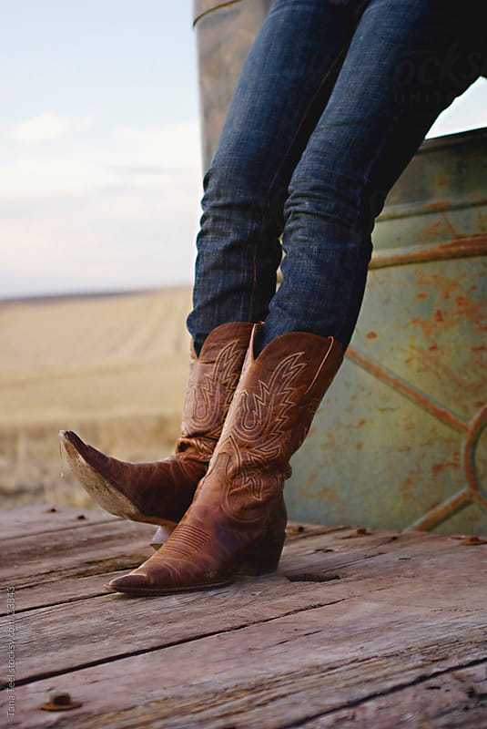 Young woman's cowboy boots. by Tana Teel for Stocksy United