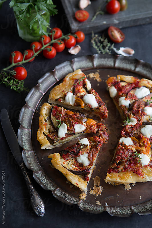 Aubergine and roasted red bell pepper tarte tatin by Aniko Lueff Takacs for Stocksy United
