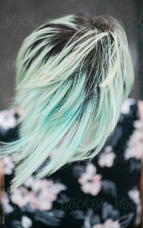 closeup of young woman with pastel hair  by Vesna for Stocksy United