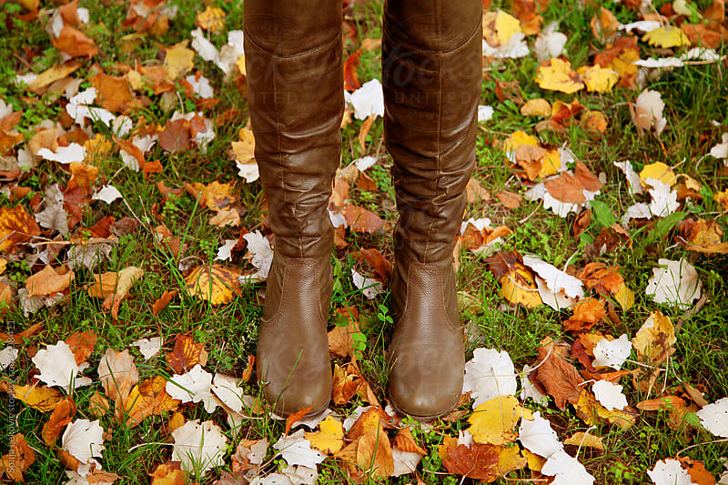 brown boots on autumn grass by Sonja Lekovic for Stocksy United