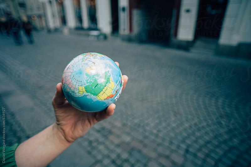 The world in a hand by Daniel Wirgård for Stocksy United