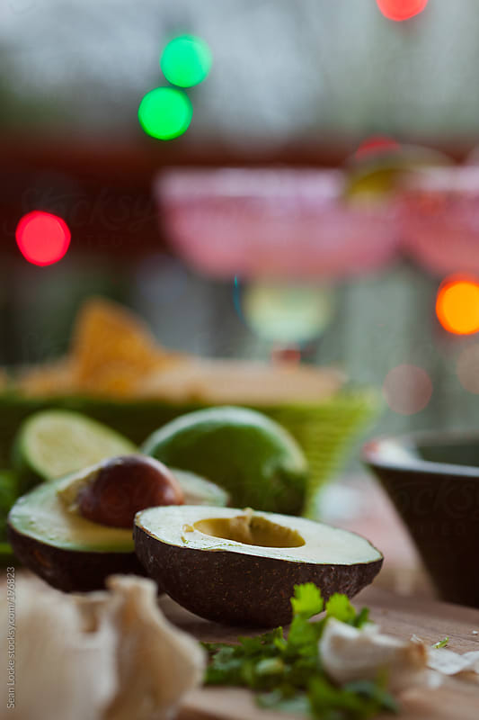 Fiesta: Avacados, Limes And Garlic For Guacamole by Sean Locke for Stocksy United
