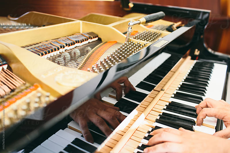Adjustment and tuning of piano by michela ravasio for Stocksy United