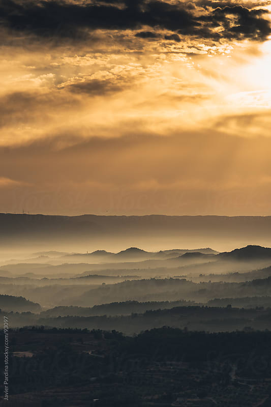 Sunset on the valley with fog by Javier Pardina for Stocksy United