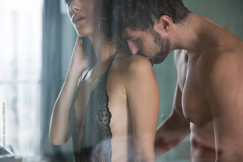 Attractive man and woman in the bathroom together  by Jovo Jovanovic for Stocksy United