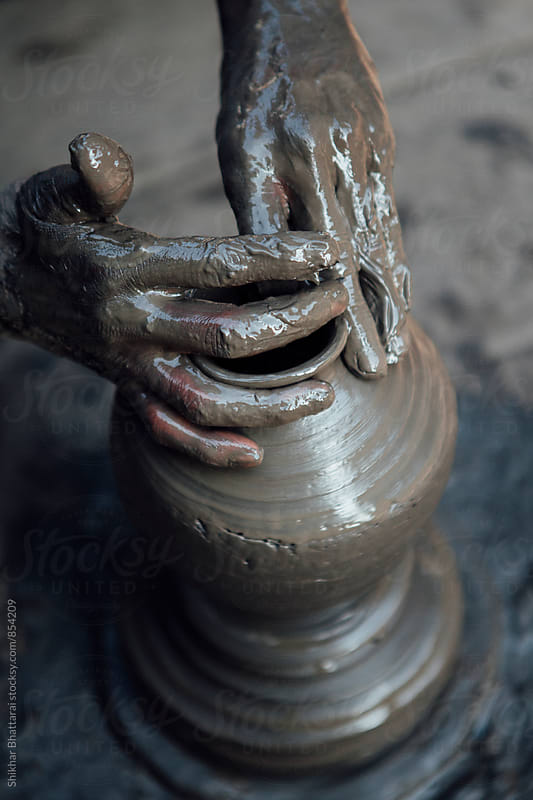 Hands of a skilled artists creating pottery items. by Shikhar Bhattarai for Stocksy United