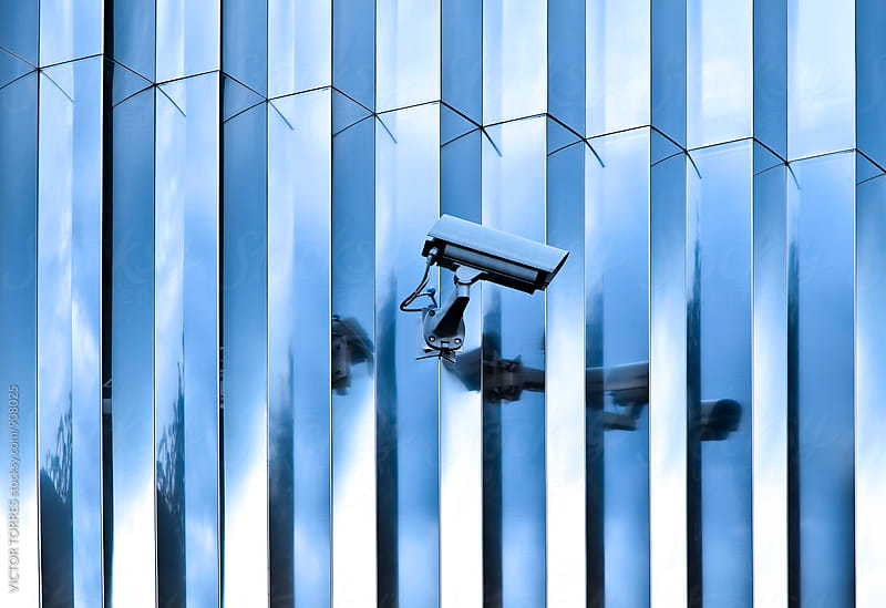 Surveillance Equipment in a Modern Building by Victor Torres for Stocksy United