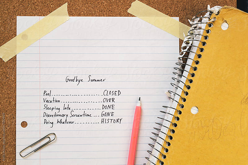 list of events marking the end of summer, surrounded by school supplies  by Kelly Knox for Stocksy United