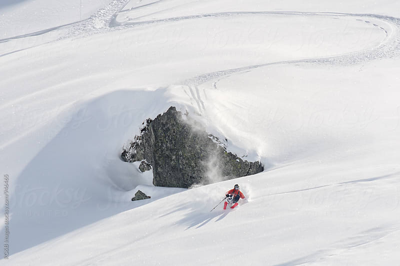 Skier making a turn in deep snow by RG&B Images for Stocksy United