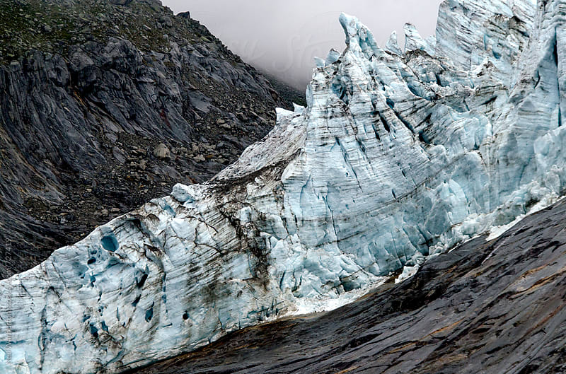 Alpine glacial ice by Neil Warburton for Stocksy United