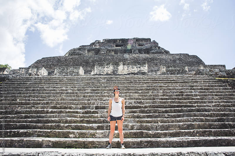 Woman Standing on Steps to Ancient Mayan Temple by MEGHAN PINSONNEAULT for Stocksy United