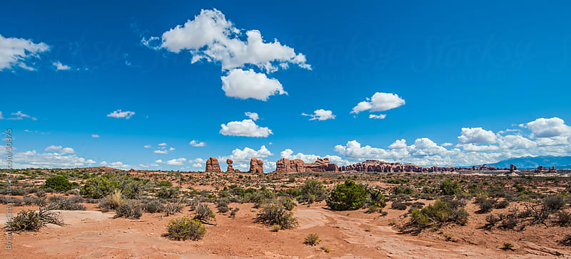 Western Landscape: Puffy Clouds Over Arches National Park by Brian McEntire for Stocksy United