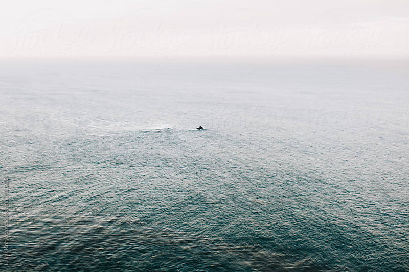 Lonely rock in the middle of sea by Lukas Korynta for Stocksy United