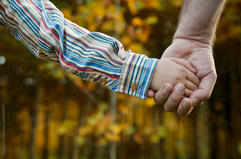 father and son holding hands by Marija Anicic for Stocksy United