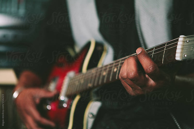 Musicians hands playing a guitar by kkgas for Stocksy United