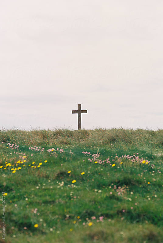 cross by the sea side by Léa Jones for Stocksy United