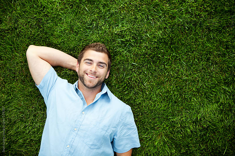 Grass: Cheerful Guy Lying in Grass by Sean Locke for Stocksy United