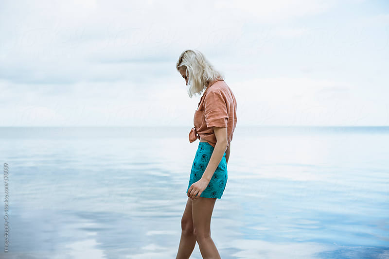 young woman walking  lakeside by Image Supply Co for Stocksy United