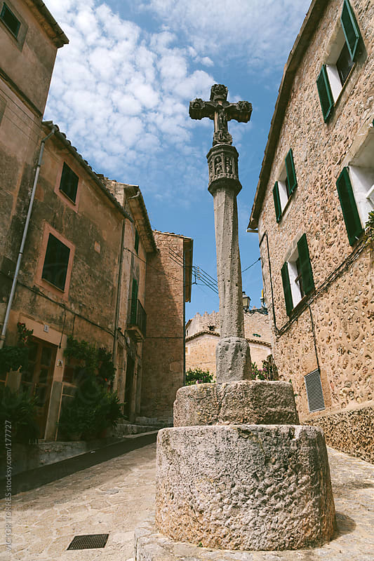 Stone Cross in the Streets of Valdemossa by VICTOR TORRES for Stocksy United