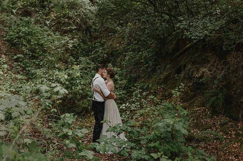 Bride and Groom in the Forest by Sidney Morgan for Stocksy United