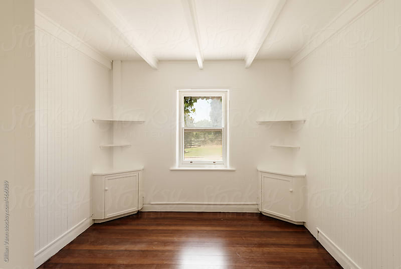 empty room with freshly painted white walls and polished timber floors by Gillian Vann for Stocksy United