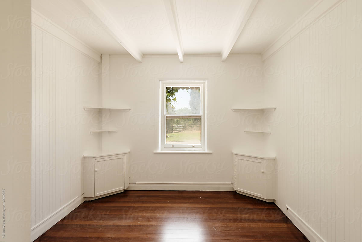 Empty Room With Freshly Painted White Walls And Polished