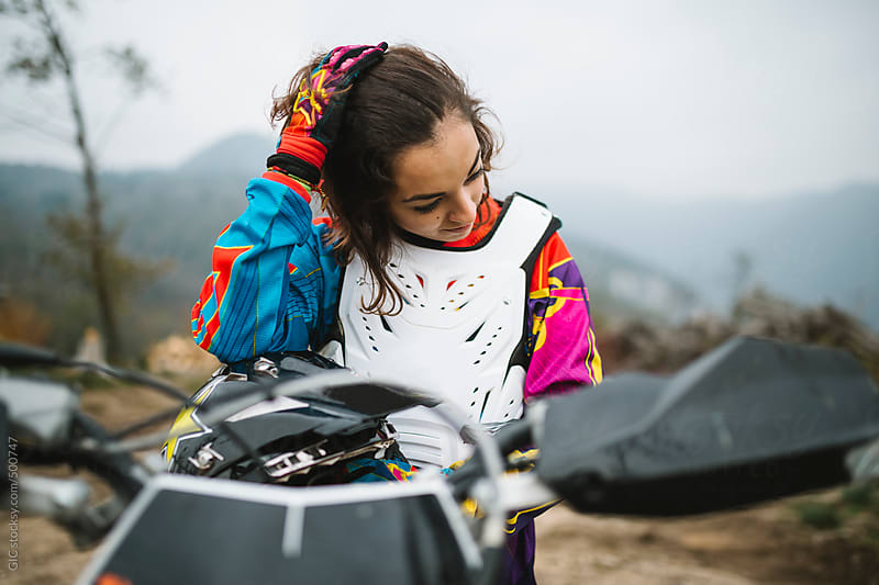 Young woman on her motorbike by GIC for Stocksy United