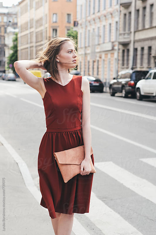 Young woman walking on the street by Lyuba Burakova for Stocksy United