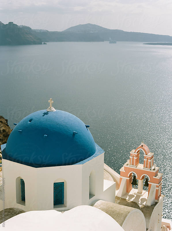 Traditional blue church dome and bell tower, Santorini by Kirstin Mckee for Stocksy United