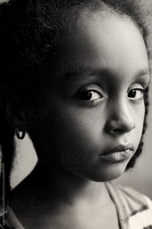 Portrait of young girl with a serious look on her face by anya brewley schultheiss for Stocksy United