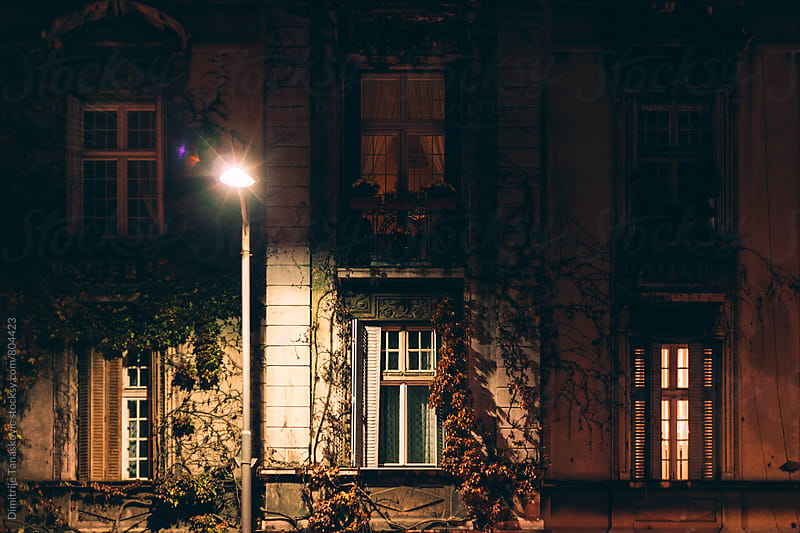 Facade of the old house lit by the street lighting by Dimitrije Tanaskovic for Stocksy United