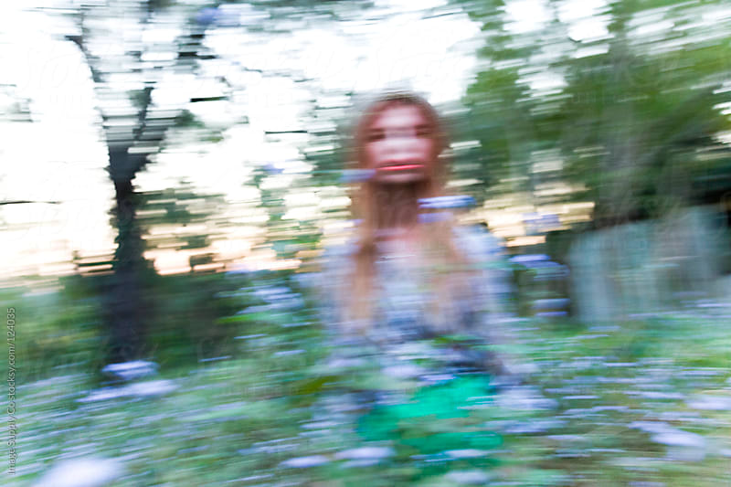 Psychadelic motion shot of model in a field by Image Supply Co for Stocksy United